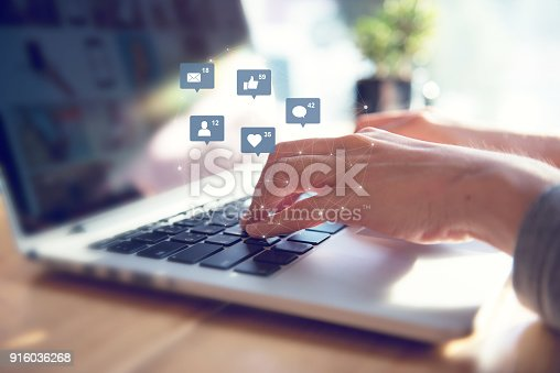 istock Businesswoman hands using laptop with icon social media and social network. 916036268