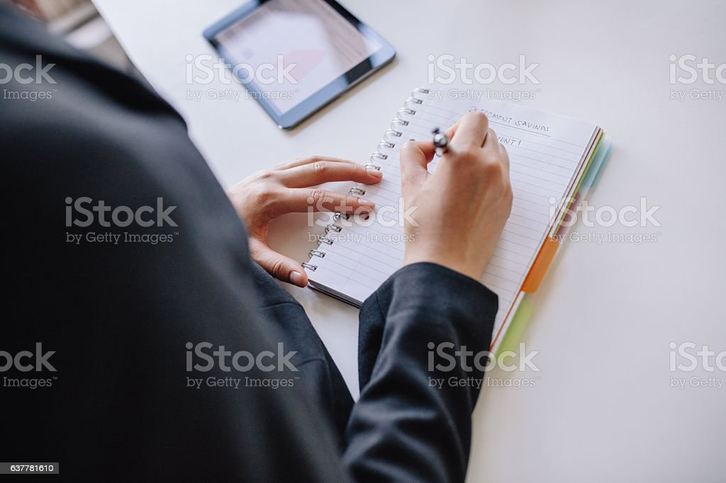 Businesswoman hands writing on notepad stock photo