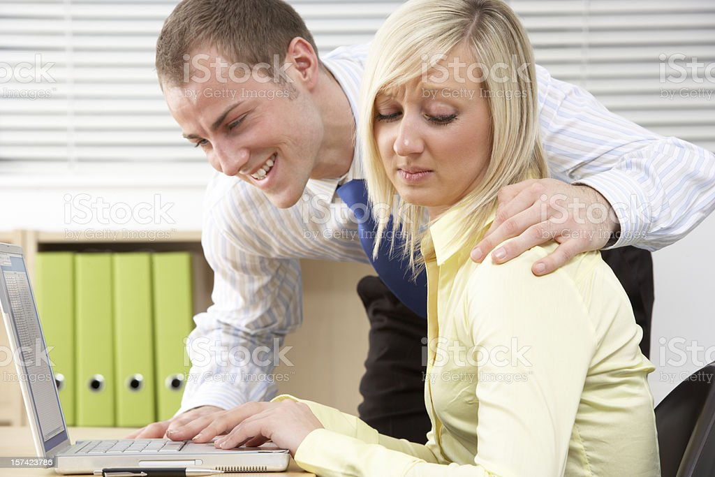 Businesswoman Harassing Female Colleague stock photo