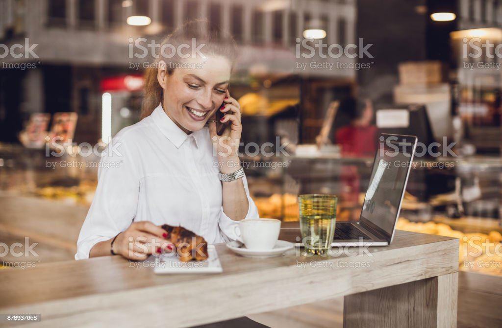 Businesswoman Having a Break in The Cafeteria