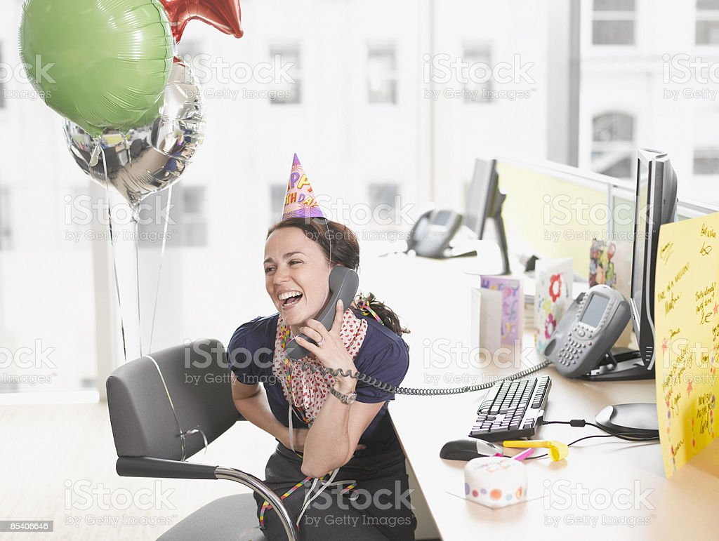 Businesswoman having birthday party at desk royalty-free stock photo
