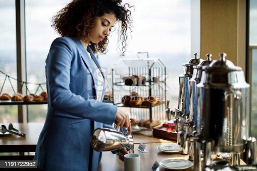 Businesswoman having coffee break at business meeting