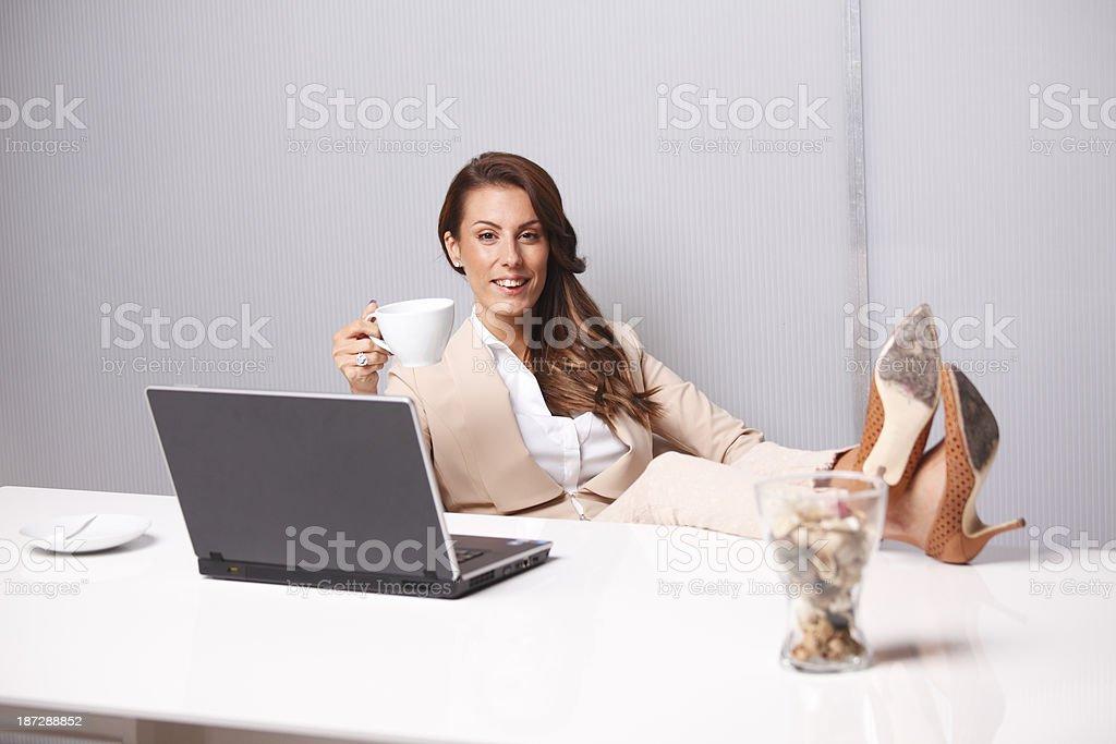 Businesswoman having coffee break stock photo