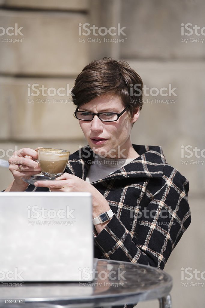 Businesswoman having cup of coffee royalty-free stock photo