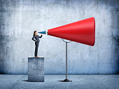 istock Businesswoman Having Her Voice Amplified 604360742