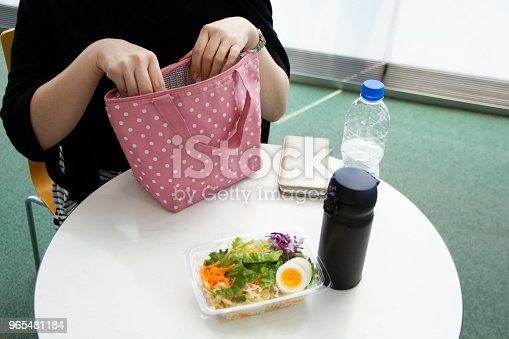 istock Businesswoman having lunch break 965481184