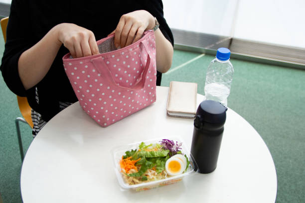 Businesswoman having lunch break stock photo
