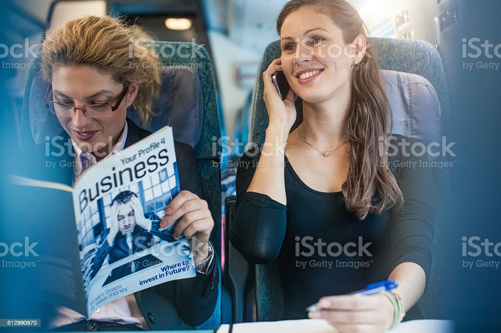 Businesswoman having meeting on the train stock photo