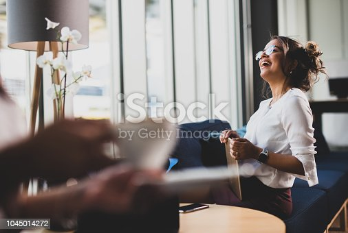 912944158istockphoto Businesswoman having pause. 1045014272