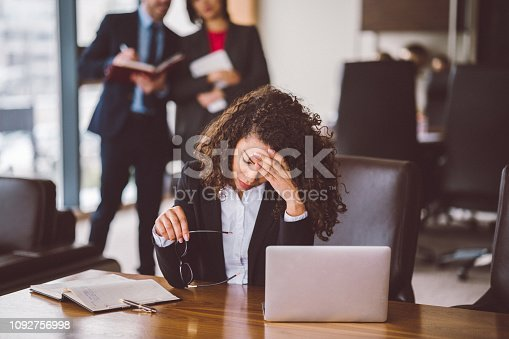 Worried mixed race businesswoman at work