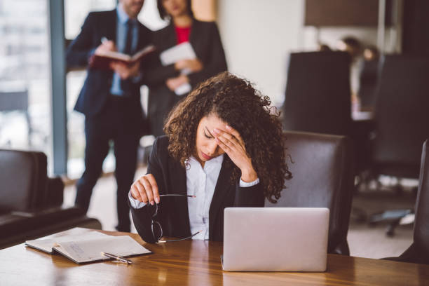 Businesswoman having problems in the office Worried mixed race businesswoman at work disappointment stock pictures, royalty-free photos & images