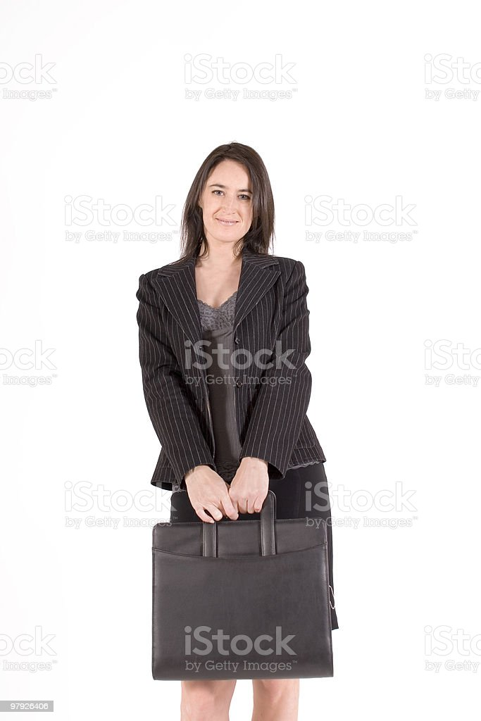 Businesswoman holding a briefcase royalty-free stock photo