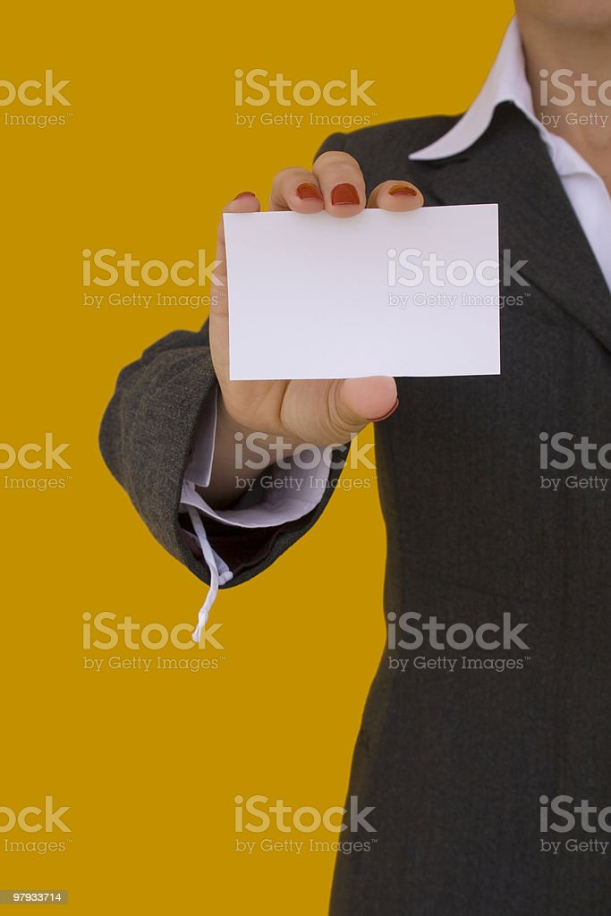 businesswoman holding a card royalty-free stock photo