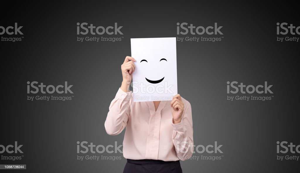 Businesswoman Holding A Card With Drawing Facial Expressions Illustrations Emotion Feelings Face On White Paper Stock Photo Download Image Now Istock