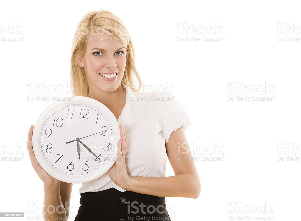Businesswoman holding a clock royalty-free stock photo