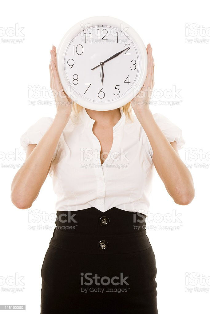 Businesswoman holding a clock stock photo