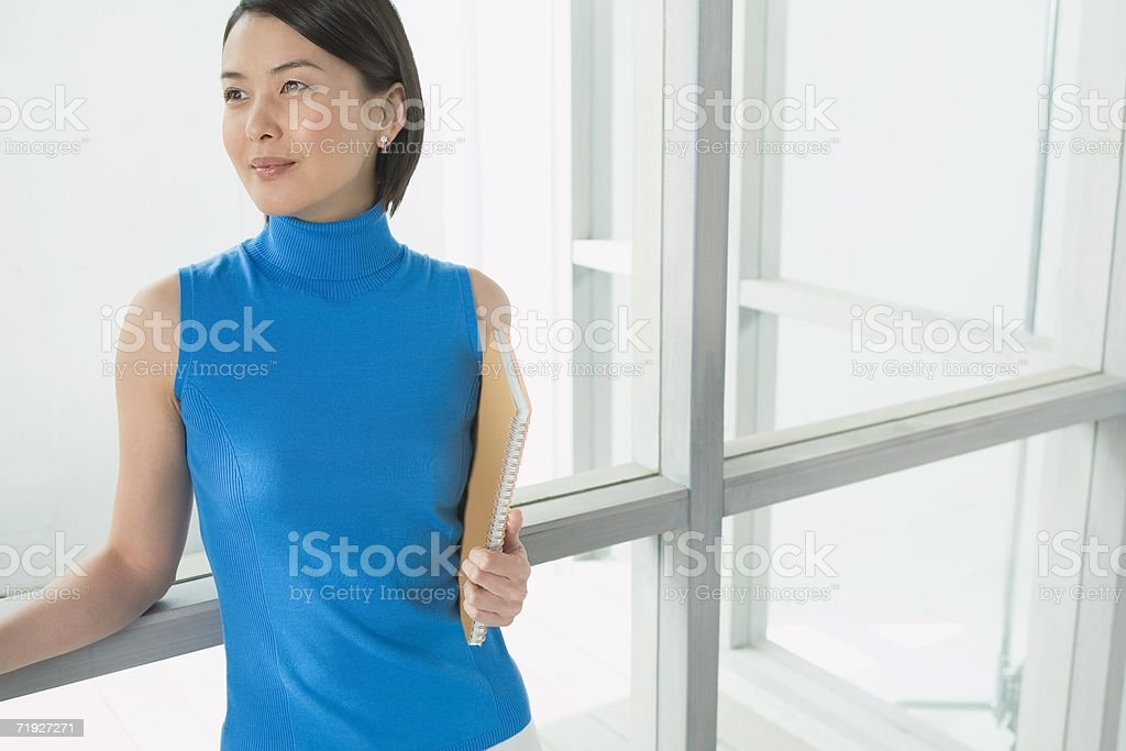 Businesswoman holding a file royalty-free stock photo