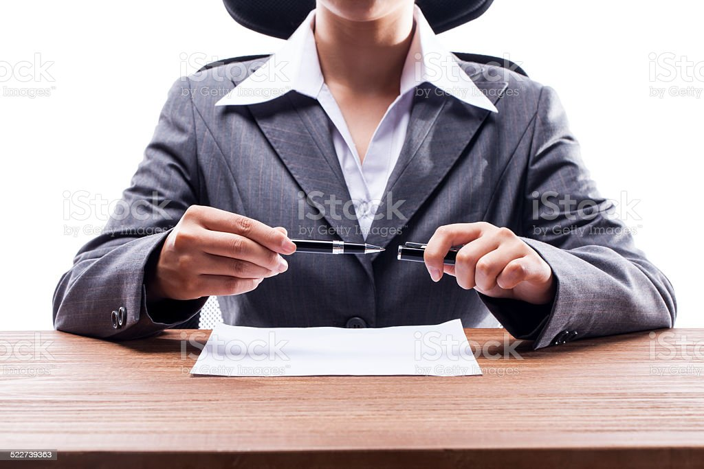 Businesswoman Holding a Pen stock photo