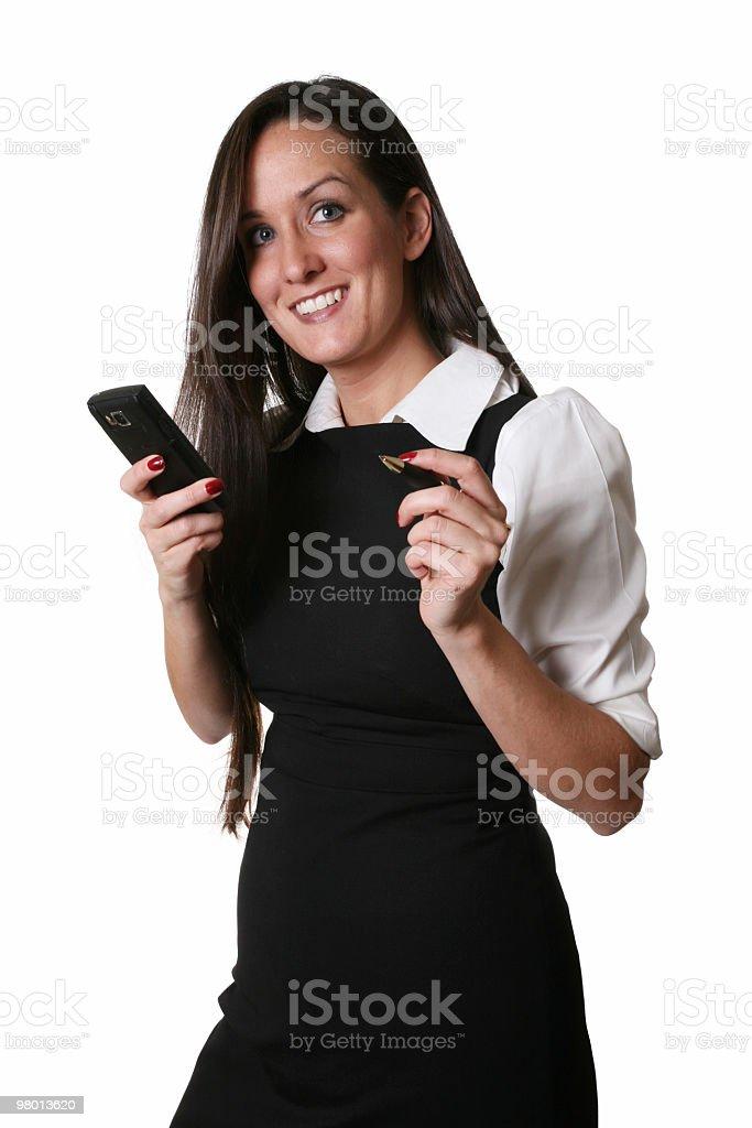 Empresária segurando um telefone e caneta foto royalty-free