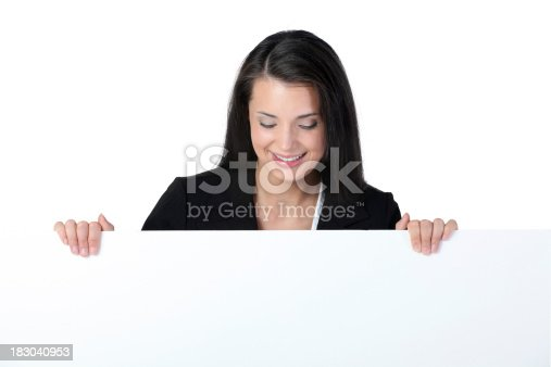 157609352 istock photo Businesswoman holding a placard and smiling 183040953