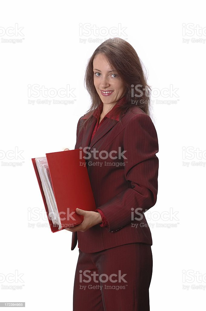 Businesswoman holding a red folder. Isolated on white royalty-free stock photo