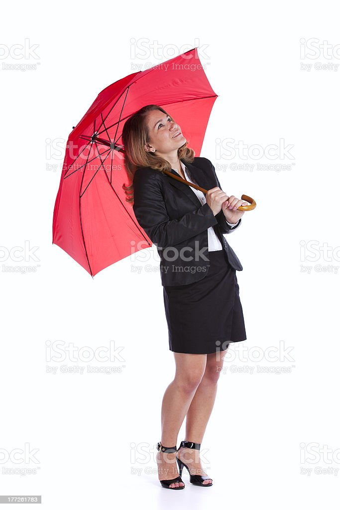 Businesswoman holding a red umbrella royalty-free stock photo