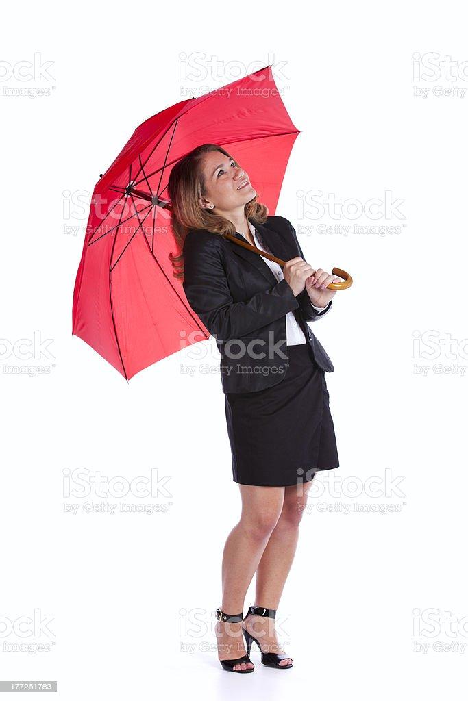 Geschäftsfrau hält einen roten Regenschirm – Foto