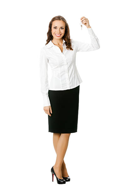 A businesswoman holding a set of keys up stock photo