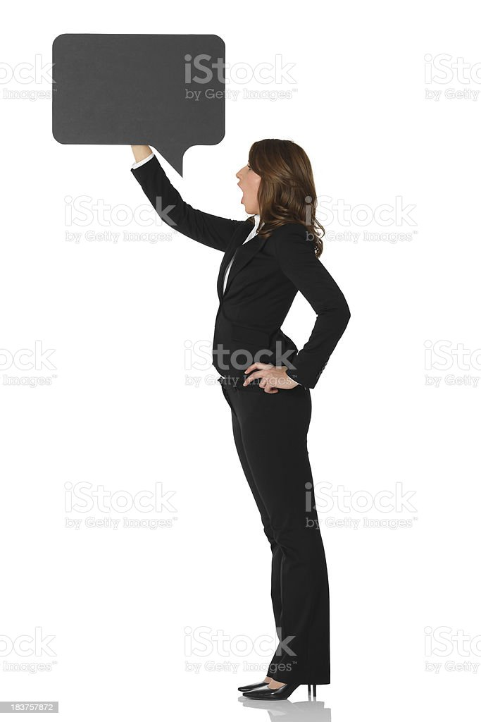 Businesswoman holding a speech bubble royalty-free stock photo