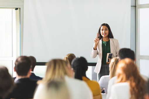 Businesswoman of Indian descent speaking at a seminar