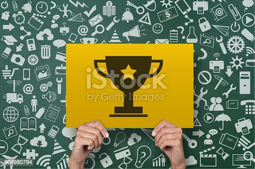 istock Businesswoman holding award trophy placard 804980794