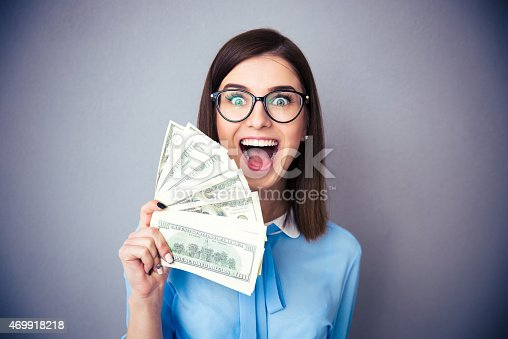 istock Businesswoman holding bill of dollars and shouting 469918218