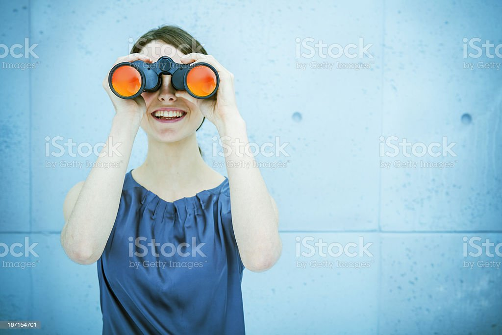 Businesswoman holding binoculars stock photo