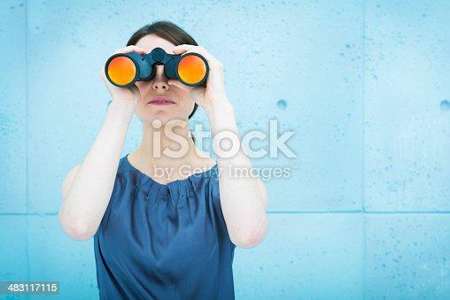 Business vision: woman holding binoculars