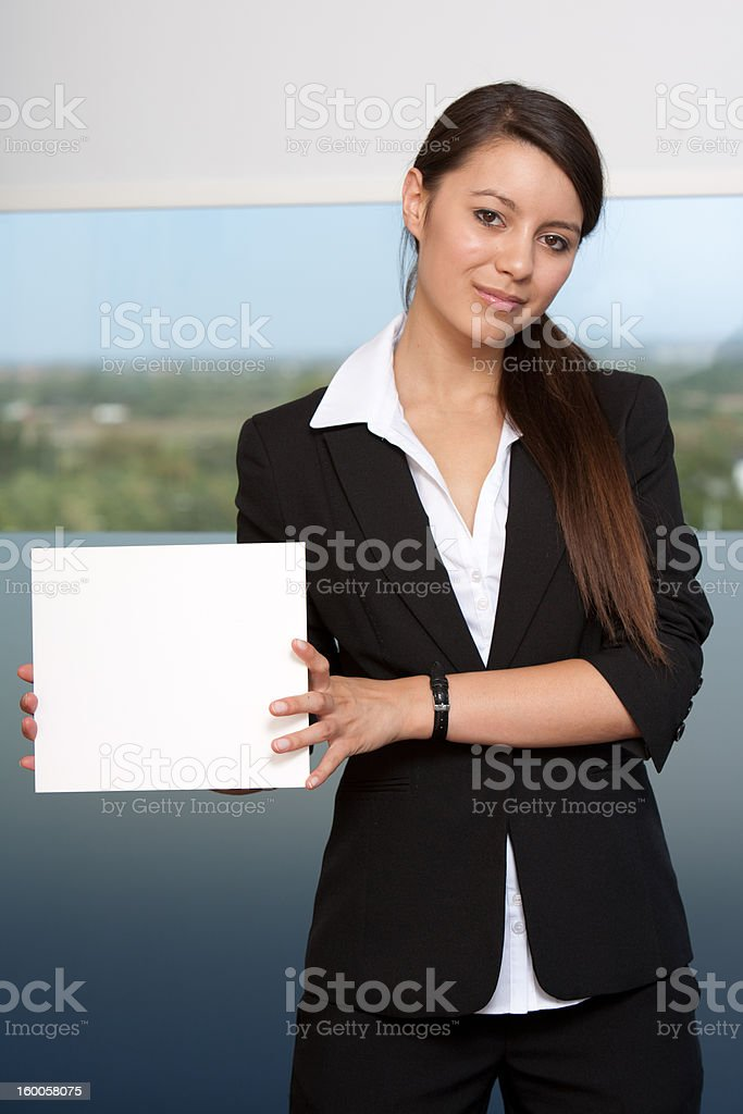 Businesswoman holding blank card royalty-free stock photo