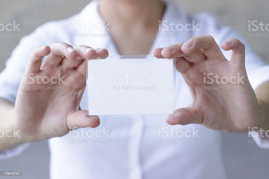 Businesswoman holding blank credit card in hand royalty-free stock photo