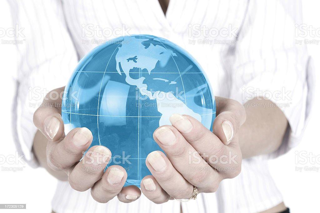 Businesswoman holding blue globe royalty-free stock photo