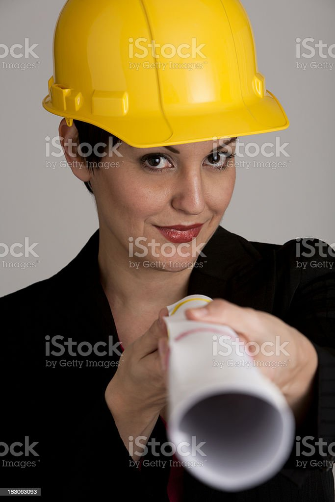 Businesswoman holding blueprints royalty-free stock photo