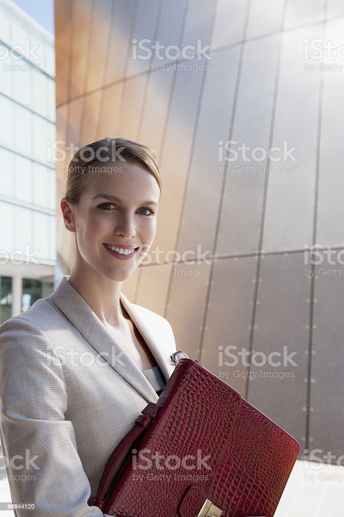 Businesswoman holding briefcase 免版稅 stock photo