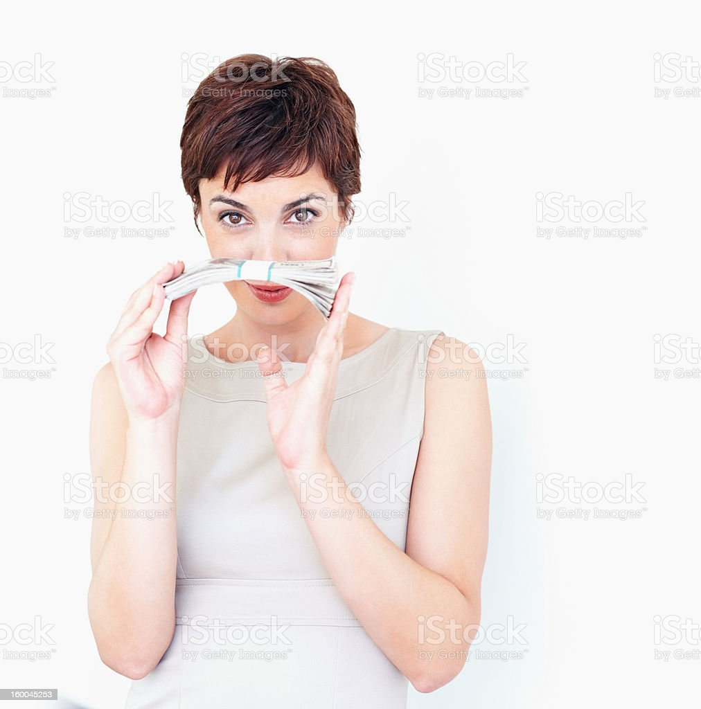 Businesswoman holding bundle of paper currency royalty-free stock photo