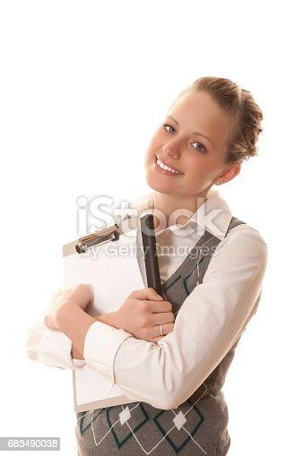 istock Businesswoman holding clipboard 683490038