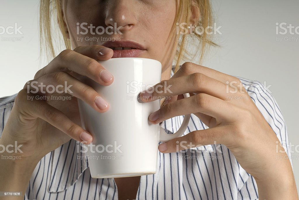 Businesswoman holding coffee cup, close-up royalty-free stock photo