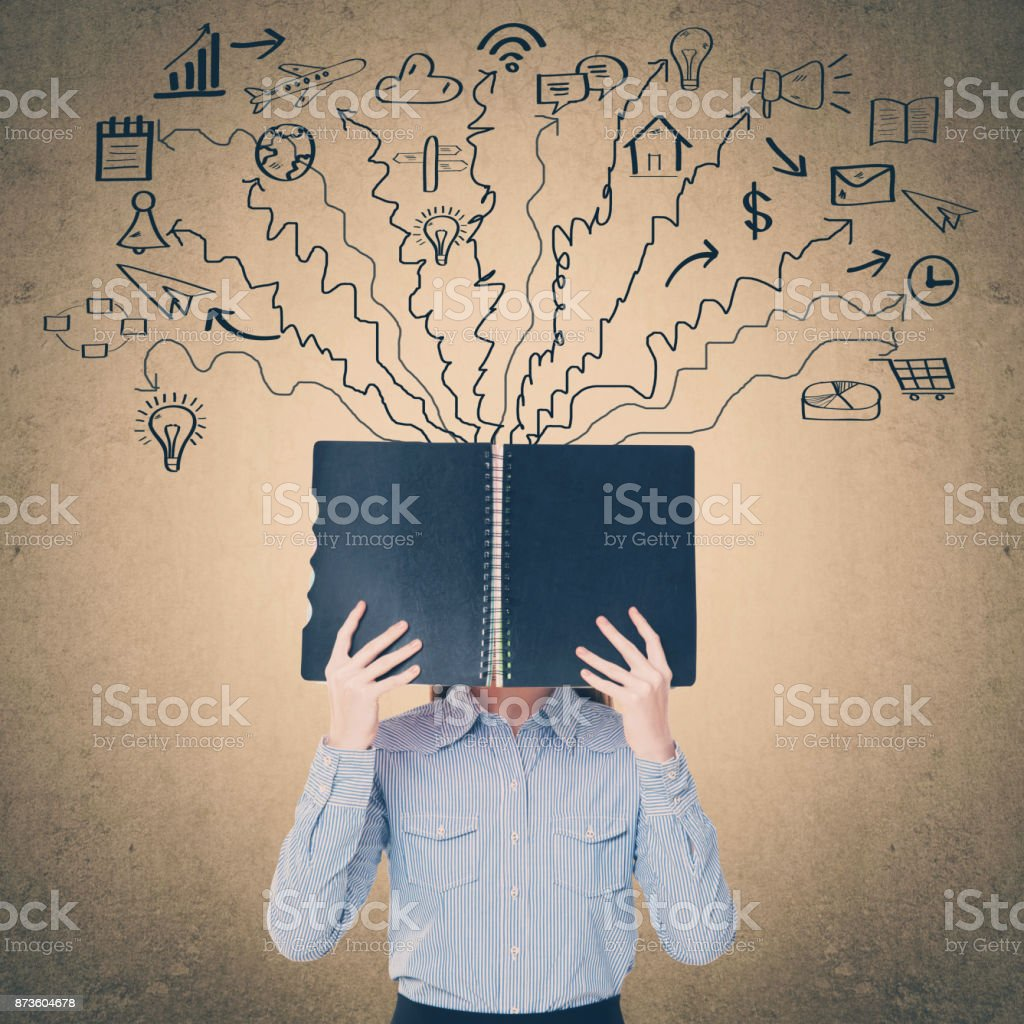 Businesswoman holding diary in front of her face stock photo