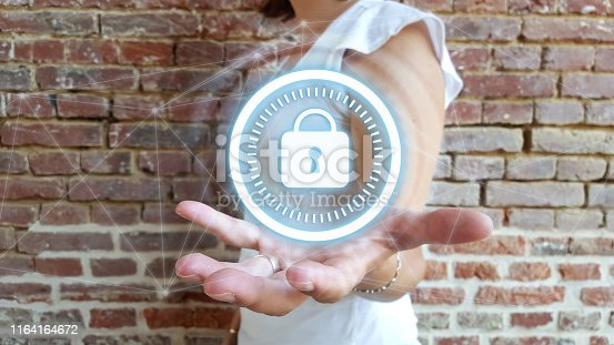istock Businesswoman holding digital padlock with data protection 1164164672