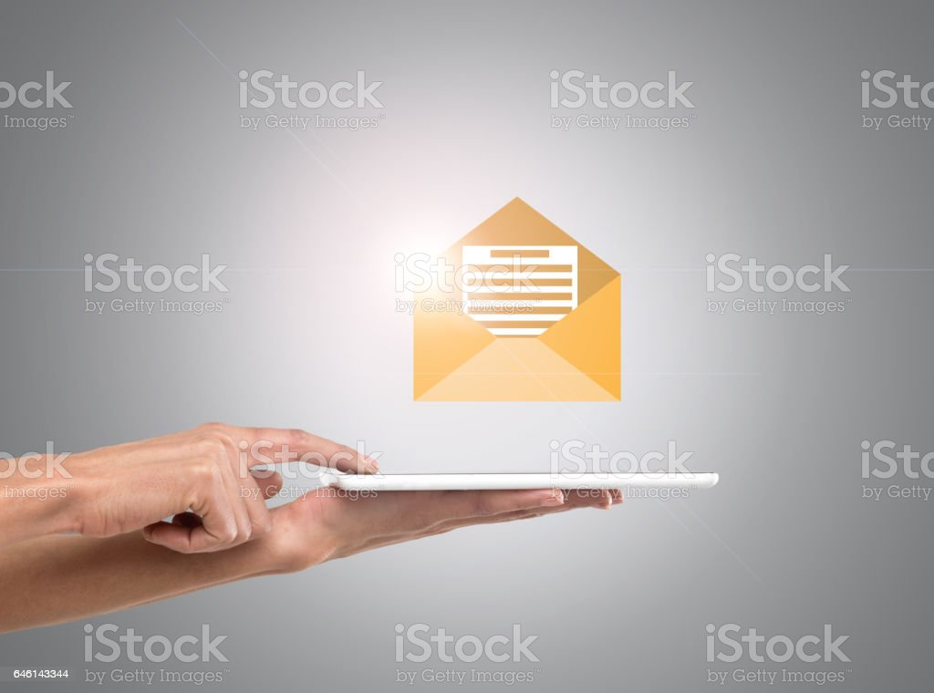 Businesswoman holding digital tablet with inbox e-mail icon stock photo