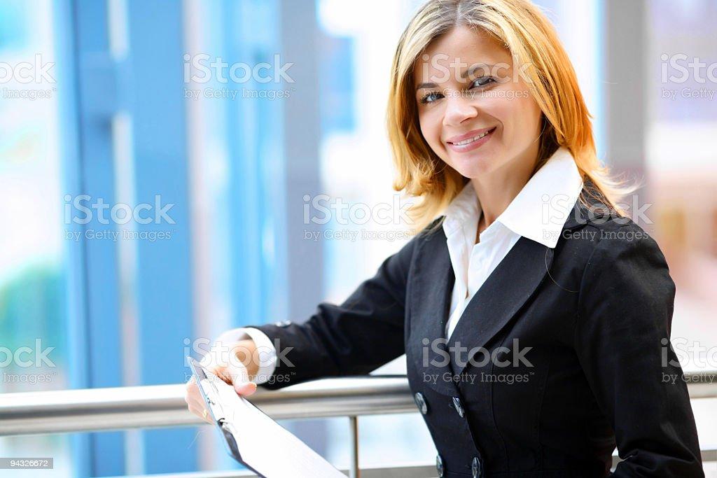 Businesswoman holding document. royalty-free stock photo