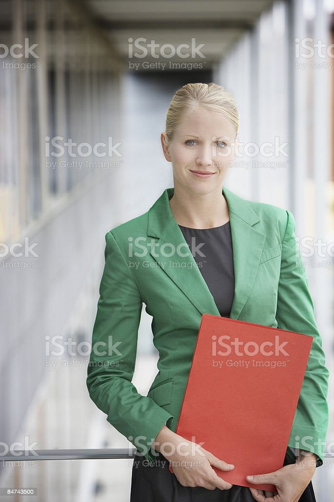Businesswoman holding file royalty-free stock photo