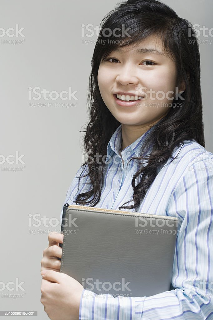 Businesswoman holding file, smiling, portrait royalty-free 스톡 사진
