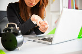 istock businesswoman holding her wrist pain from using computer 1071252824