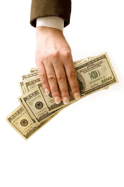 Businesswoman holding hundred dollar bills stock photo